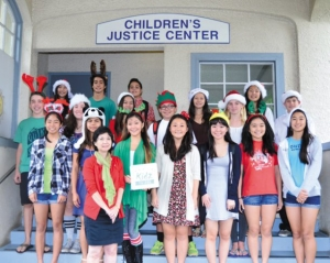The K4AC board of directors brought Christmas presents to the Children's Justice Center to put under the tree for the kids. They did this in lieu of secret Santa for each other. Front left is CJC state director Jasmine Mau-Mukai